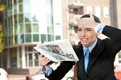 shocked woman reading newspaper on street, oh no bad news