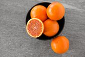 food, fruits and healthy eating concept - close up of fresh juicy blood oranges poster