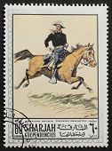 SHARJAH (UAE) - CIRCA 1969: a stamp printed in Sharjah (Emirate) shows a picture of a union horseman