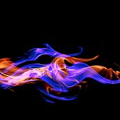 Fire - a wave of colored plasma fire elements consisting of a hot red-orange flame on a black backgr poster