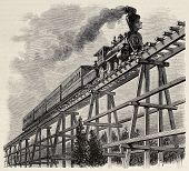 Old illustration of train crossing wooden trestle bridge along Union Pacific railroad. Original, cre