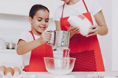 Young Girl Preparation Sugar For Sweet Biscuit And Sweet Pancakes. Mother Help Yung Girl With Prepar poster