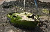 Wreck Of A Small Sailing Boat On The Mud At Low Tide On The River Torridge At Appledore In North Dev poster
