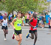 VICTORIA, BC, CANADA - OCTOBER 10: Runners James Lander (Esquimalt, BC), Philip Samoei, and Bernard Onsare compete at the GoodLife Fitness Victoria Marathon October 10, 2010 in Victoria, BC, Canada.