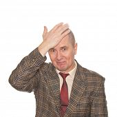 A businessman smacking his forehead. Isolated on white. Body language. Disappointment. Self-accusati