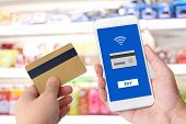 Hand Holding Credit Card And Smart Phone With Online Payment On Device Screen Background, Shopping O poster