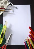 tools around a blank art paper