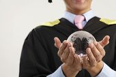 mid section of the man holding glass globe