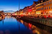 Evening View Of Nyhavn District In Copenhagen, Denmark poster