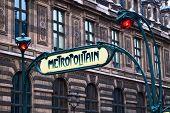 Paris Metropolitain sign agains the wall