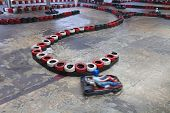 Race between safety barriers in indoor carting hall
