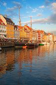Copenhagen (Nyhavn district) at the sunset poster