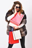 Girl Wear Sunglasses And Fur Coat Shopping White Background. Lady Hold Shopping Bags. Discount And S poster