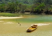Stationary yellow boat on calm lake