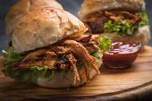 Burger with pulled pork, classic american meat sandwich poster