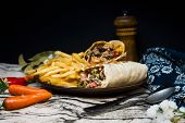 Mexican fajita wraps with grilled chicken fillet and fresh vegetables poster
