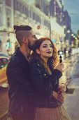 Couple In Love On Date. Boyfriend Hugs And Kisses Girl From Behind. She Smokes An Electronic Cigaret poster