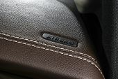Modern Sport Car Brown Leather Interior. Part Of Leather Car Cockpit Details With Stitching. Car Det poster