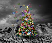 pic of ozone layer  - Christmas tree with butterflies on dried and cracked soil - JPG