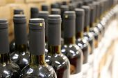 Wine Bottles In A Row, Shallow Depth Of Field. Liquor Store, Wine Production Concept poster