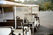 close up shot of several white golf carts