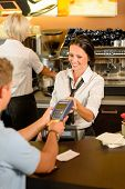 Man paying bill at cafe using card bill happy waitress
