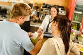 picture of receipt  - Man checking receipt at cafe restaurant payment waitress couple bar - JPG