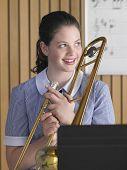 Retrato de uma aluna com trombone