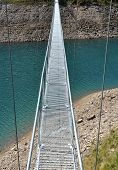 Alpine Footbridge Over Lake