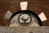 stock photo of castello brown  - the pigeon over the door in san babila in milan - JPG