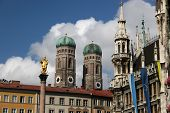 Munich In Germany With The Landmarks MariensäUle, Liebfrauenkirche And Town Hall