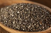 stock photo of flax seed  - Organic Dry Black and White Chia Seeds against a background - JPG