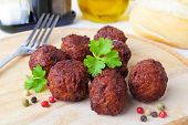 stock photo of meatball  - meatballs with pepper and parsley on a wooden board - JPG