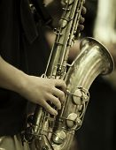 stock photo of sax  - jazz band playing on the street - JPG