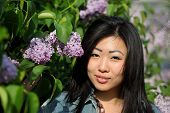 Portrait of a pretty asian girl in flowers