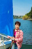 Asian Woman and Sailboat