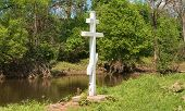 Cross on the riverbank