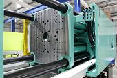 pic of thermoplastics  - Injection moulding machine used for the forming of plastic parts using plastic resin and polymers - JPG