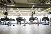 MOSCOW - AUGUST 28: Four black cars raised on lifts in garage Avtomir on Baykalskaya, on August 28,