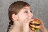Girl Eating A Hamburger