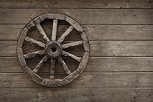 Old Wagon Wheel On Wooden Wall