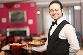 Smiling waiter portrait