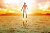 stock photo of human beings  - Silhouette illustration of human figure floating on water - JPG