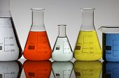 beakers group with multicolor liquid against a white background