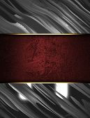 Abstract metal background with a red nameplate for writing.