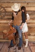 Cowboy And Indian Woman Saddle She Looks