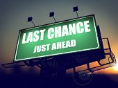 Last Chance Just Ahead on Green Billboard.