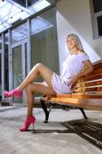 image of school-leaver  - Beautiful blonde woman on a bench is waiting job interview - JPG