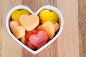 stock photo of cantaloupe  - Valentines Day child friendly healthy treat with heart - JPG