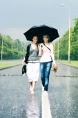 Two Women In A Heavy Rain